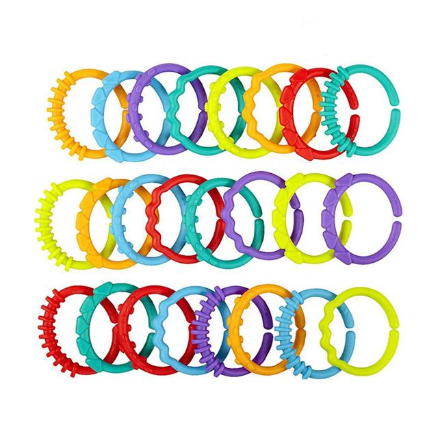 24 шт. ребенка прорезыватель игрушка 0 м + детские гремят красочные радуга кольца конструкции-кроватки кровать коляска висит-профессиональны игрушки