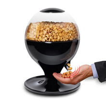 Free shipping/1units The new candy nuts Canister auto-sensing assignment candy machine/activated by movement candy dispenser(China (Mainland))