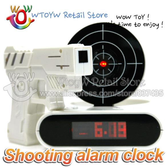 10pcs/lot free shipping new 2014 novelty Lazy shooting target practice close alarm clock electronic toys(China (Mainland))