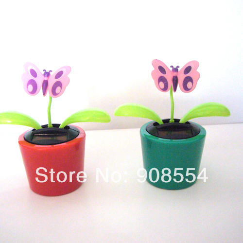 Wholesale 15 Pcs Per Lot Magic Cute Flowers Gently Car Decoration Flip Flap Happy Dancing Novelty Solar Gift(China (Mainland))