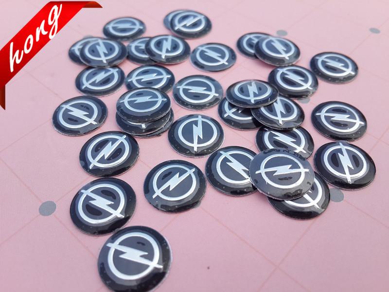 14MM Opel Car logo auto Key Fob Emblem Badge Radio button Sticker 5pcs/lot Free shipping Key stickers Key stickers(China (Mainland))