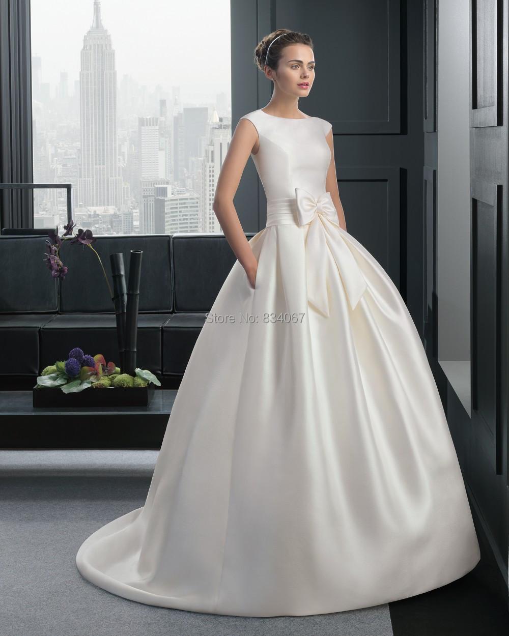 Modest wedding dress bow 2015 elegant bridal gown ball for Modest elegant wedding dresses