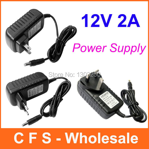 100pcs AC/DC 12V 2A Power adapter charger Power Supply 5.5mm x 2.5mm US / EU / UK for Led Strips Lights Free shipping wholesale(China (Mainland))