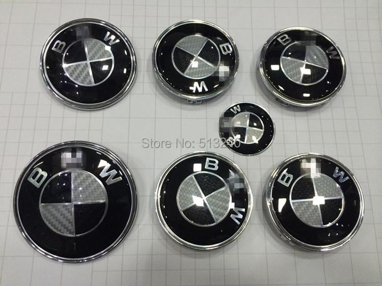 SET 7 CARBON FIBER EMBLEM BADGE FRONT BONNET REAR BOOT WHEEL CAPS STEERING(China (Mainland))