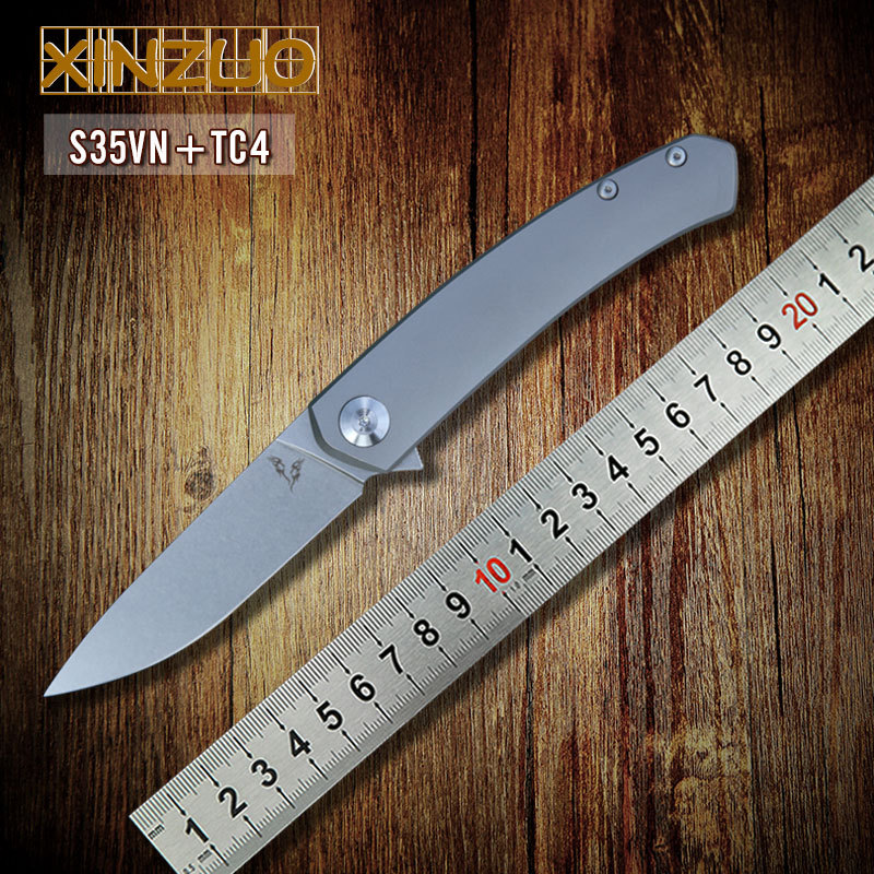 2015 NEW Design S35VN steel balde folding knife with TC4 titanium bearing handle hunting knives pocket outdoor camping EDC tools(China (Mainland))
