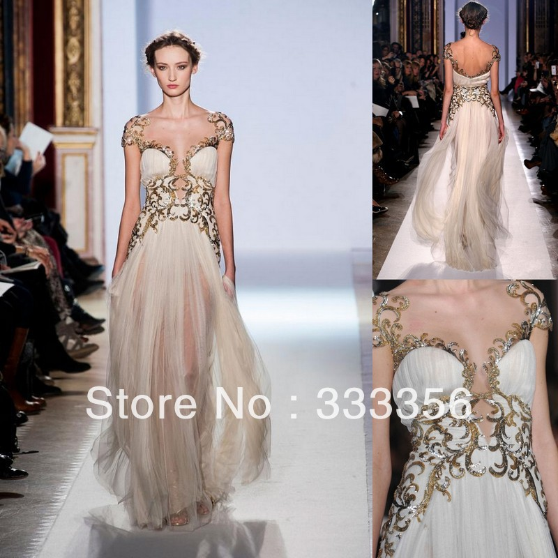 Latest design cap sleeves gold appliqued tulle champagne for Designer haute couture dresses