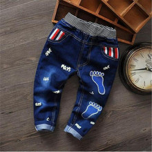 2016 Spring and Autumn children's cartoon boy footprint washed jeans elastic waistband is spring and autumn baby boy favorite