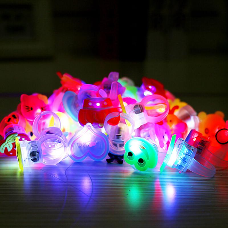 10pcs/lot Kids Cartoon LED Flashing Light Up Glowing Finger Ring Electronic Christmas Halloween Baby Fun Toys Gifts for Children(China (Mainland))