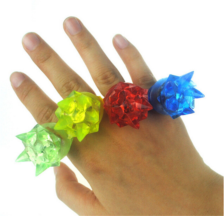 30pcs/lot Soft flashing crown finger ring rubber led finger lights glowing in the dark party supplies kids light up toys(China (Mainland))