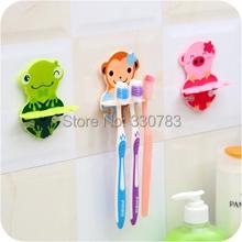 Free shipping cute Cartoon sucker toothbrush holder suction hooks vacuum sucker holder for household cartoon toothbrush holder(China (Mainland))