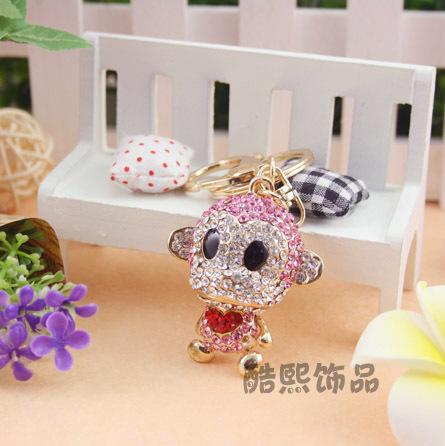 Фотография Cool city jewelry creative cute little monkey car key button creative man woman Korea import bag buckle