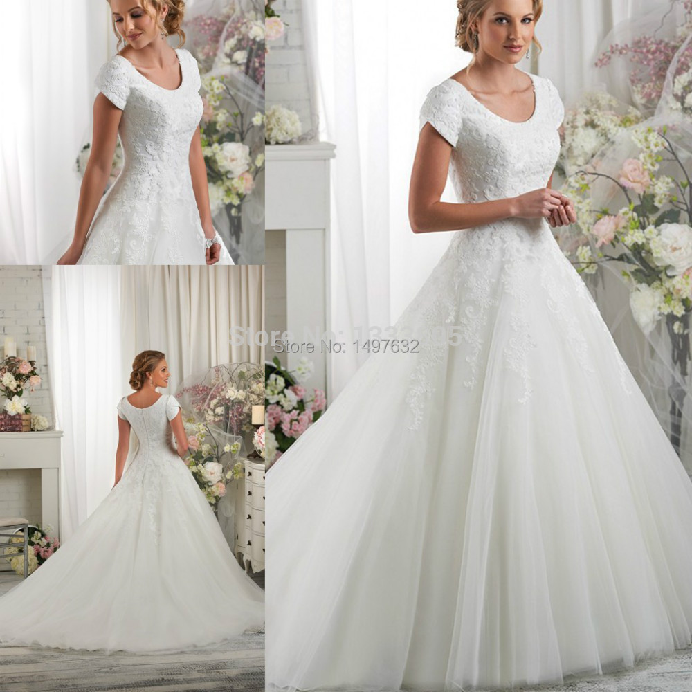 Ball Gown Wedding Dresses With Short Sleeves : Modest boat neckline ball gown appliqued beaded wedding