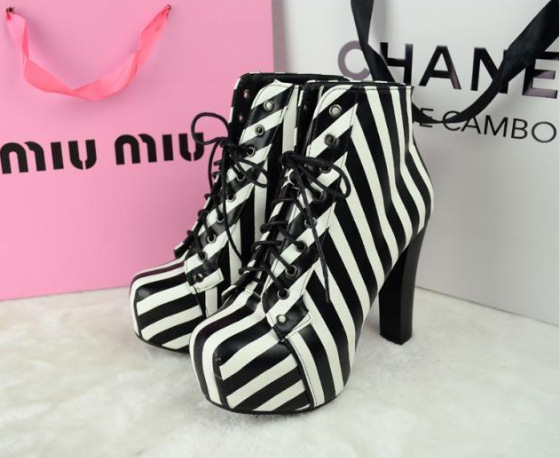 In 2014 the new European women s boots black and white striped Strappy heels Martin boots
