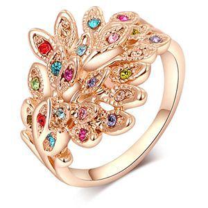 Universal mujeres de cristal austriaco 9 K chapado en oro con clase pavo real del Rhinestone boda anillo venta(China (Mainland))