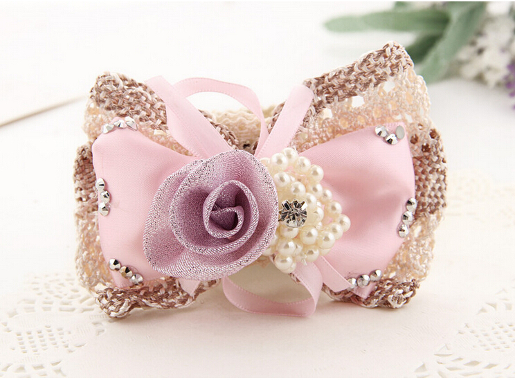 Crystal pearl ray silk big bowknot on ring hair bow,beads Super popular knot spandex Women hair accessories(China (Mainland))