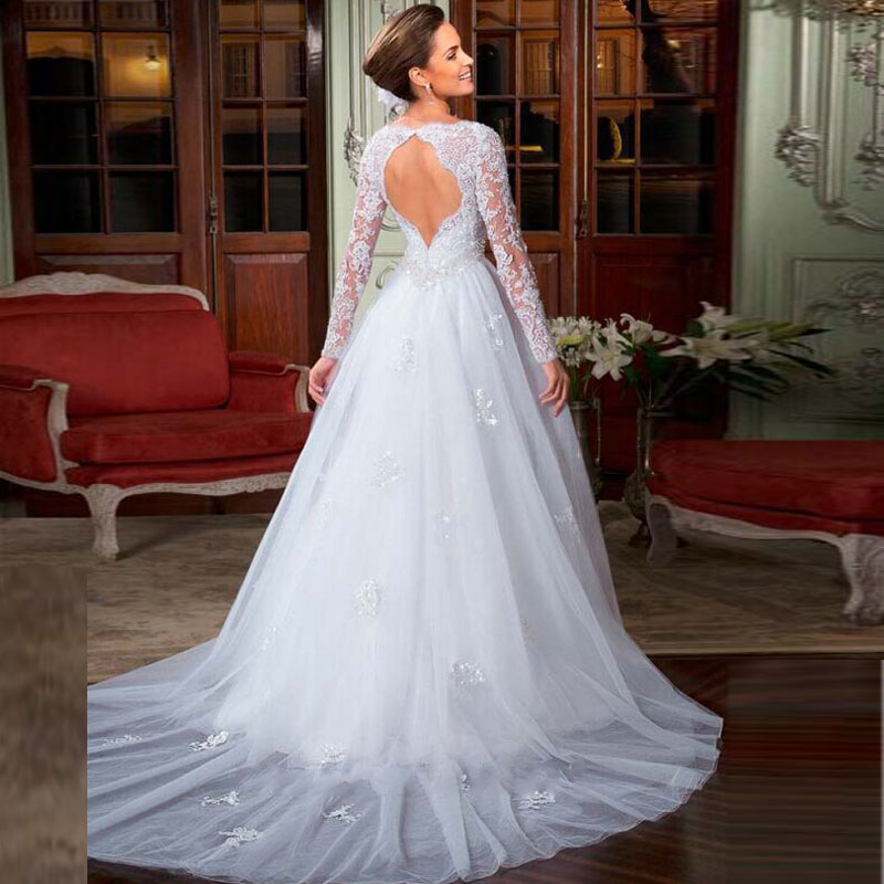 Robes l gantes robe mariage online for Wedding dress with sleeves and open back