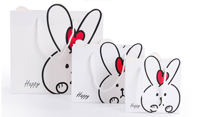 Hot selling 14*15*7 CM Thick White Paper Gift Bags Lovely Rabbit Design Festival Gift Bags Paper Bag With Handles(China (Mainland))