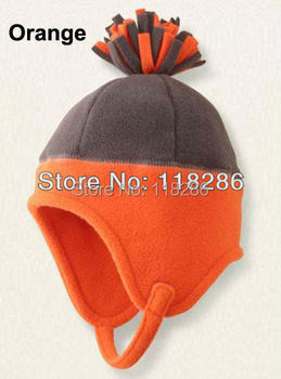 Fashion kids winter cap with fleece ball on top cute baby warm hat with earflap free shipping