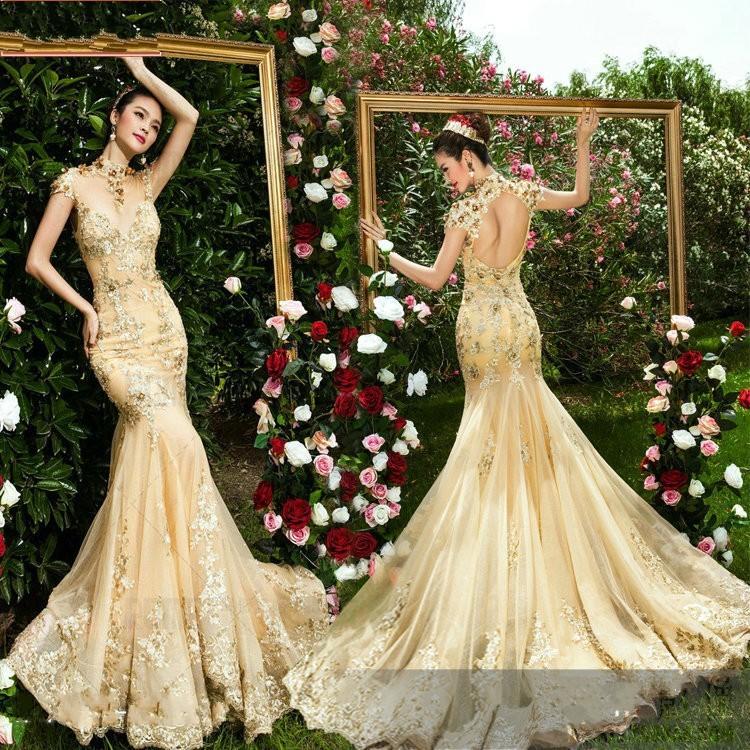 Golden Mermaid Wedding Dresses: Gold and white mermaid wedding dress ...