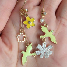 Free shipping Fashion new girl Drop Earrings pendant summer wind color little swallow flower animal bird earrings(China (Mainland))