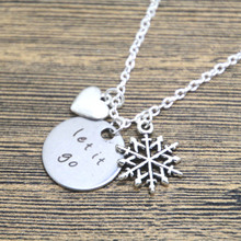 Buy 12pcs/lot Inspired Elsa Let Go Necklace Silver tone heart snowflake women girls. for $16.99 in AliExpress store