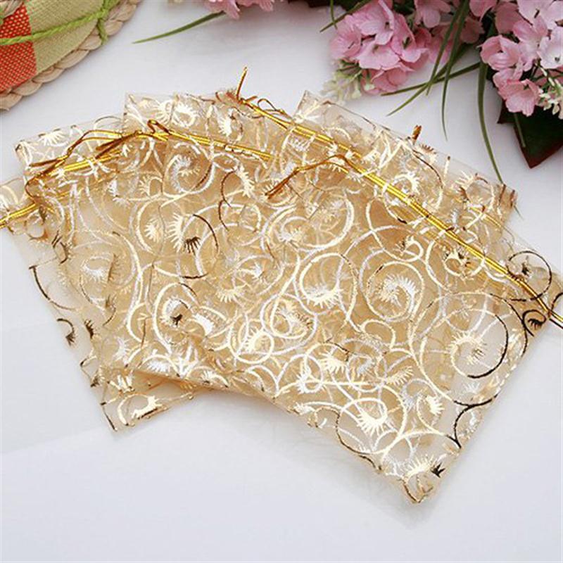 100pcs 9*12cm Cute Eyelash Pattern Drawstring Organza Wedding Favor Gift Bags Candy Bags Jewelry Pouches (Golden)(China (Mainland))