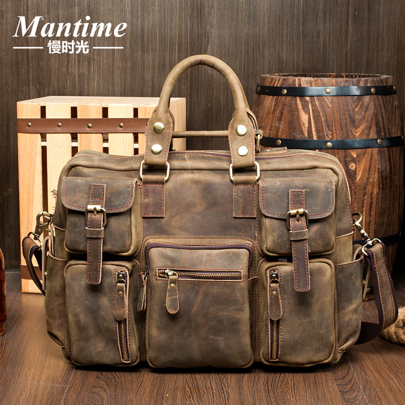 Men's cow hide shoulder bag large capacity travel bag hand luggage header layer leather large bag fashion handbag(China (Mainland))