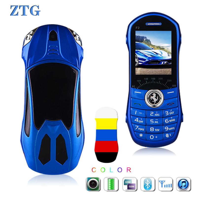 Free shipping ZTG dual SIM card mini luxury phone Bluetooth Dialer FM MP3 1.5 Inch Mini car phone English Keyboard child phones(China (Mainland))