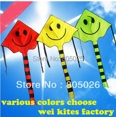 only 9.9$ high quality smiling face kite 2pcs/lot child kite nylon ripstop kite with handle line hello kitty chinese kite(China (Mainland))