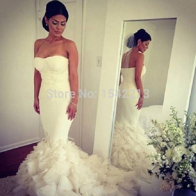 Kim kardashian wedding dress romantic strapless long white for Mermaid wedding dresses with feather bottom