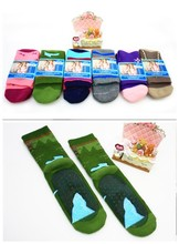 Non-skid child slipper socks with non skid slip resistant sole loop pile thickening socks with grip rubber pads on the bottom(China (Mainland))