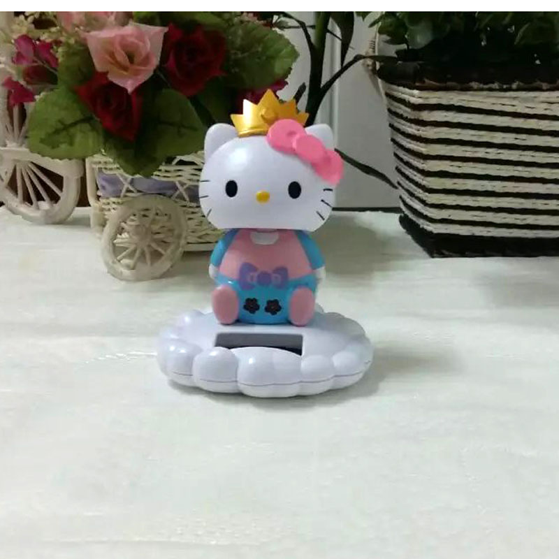 Wholesale 6 Pieces Per Lot Swing No Battery Solar Toys Flip Flap Sitting Imperial Crown Hello Kitty Novelty Home Decoration(China (Mainland))