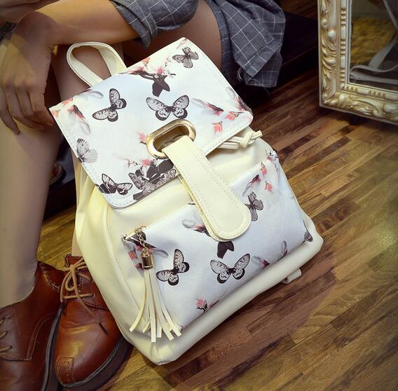 2016 nouvelle école sac à dos boucle de ceinture langue noir et blanc fleurs de qualité PU cuir à franges sac à bandoulière grande capacité(China (Mainland))