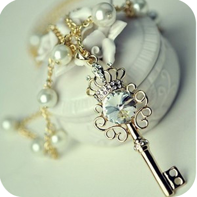 Min order is $10  rhinestone key imitation pearl necklace zircon sweater chain