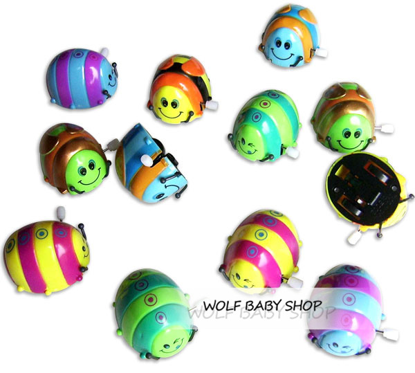 Wholesales 10pcs/lot Baby kids infants funny toys children wind-up toys,multicolor spring roll over Beetles Free shipping 2014(China (Mainland))