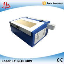 Best price Laser engraving machine 3040 Engraver cutter with 50W laser tube, honey comb and Rotary axis(China (Mainland))