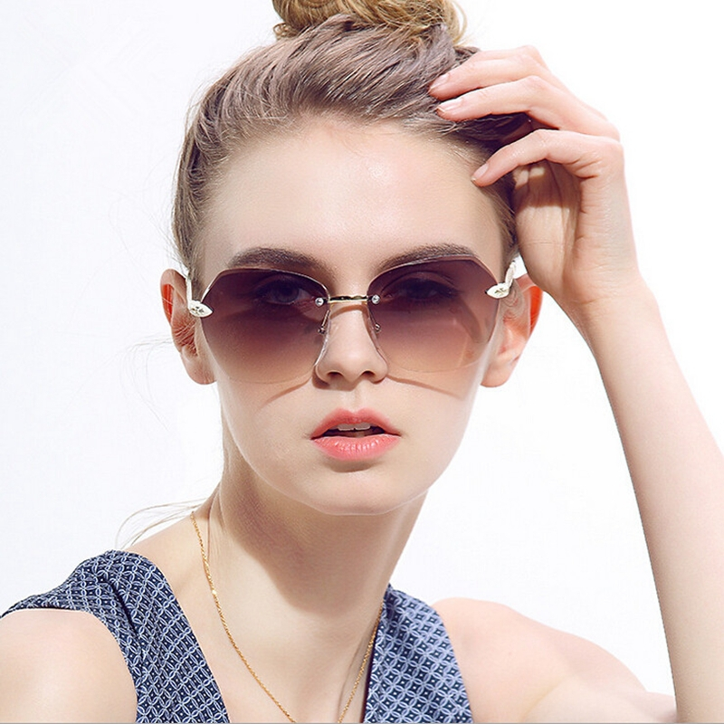 2015 sunglasses women and men Diamond trimming rimless sun glasses uneasy break lens shopping driving and fishing free shipping(China (Mainland))