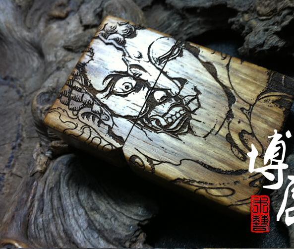 Hand carved wooden cigarette lighter African chrysanthemum pear A practicing buddhist magic version of kerosene lighter(China (Mainland))