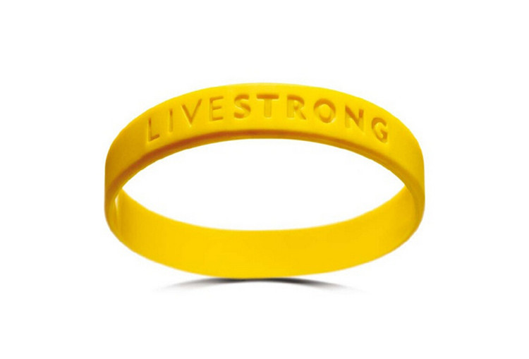 free shipping Motivational Bracelets concave lettering adults adolescent yellow non-toxic silica gel LIVE STRONG Wristband(China (Mainland))