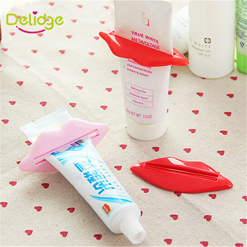 2 pcs/lot Lip Shape Squeezing Toothpaste Device Lovely Bathroom Set Dispenser Tooth Paste Squeezer Tube Partner Holder(China (Mainland))