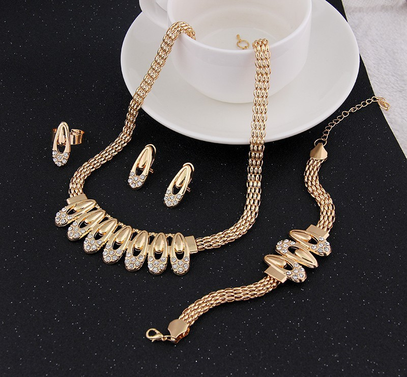 A new nice multi-layer gold necklace, bracelet, earrings, rings jewelry dress feasts the best clothing accessories(China (Mainland))