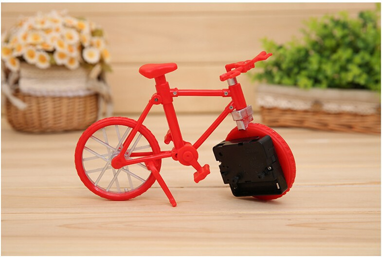 New sample Free transport 1pcs Biking Mannequin Artistic clock Child toys Birthday present Photograph Props