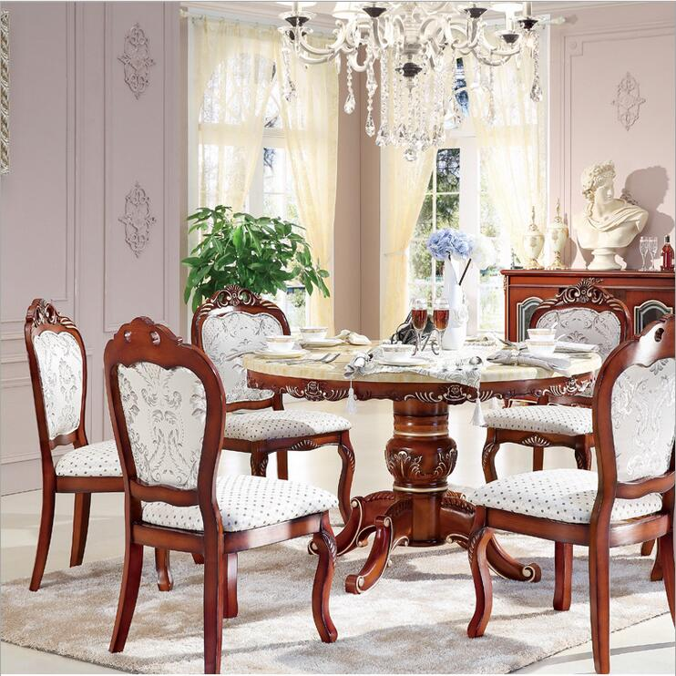 Style italian dining table round solid wood italy style for Italian dining room sets