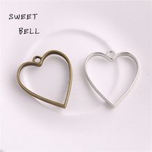 Buy Sweet Bell (20 pieces) 30*34mm Two color Alloy Hollow heart Charm Pendant Jewelry Making Pendant DIY Handmade Craft D6068-1 for $4.20 in AliExpress store
