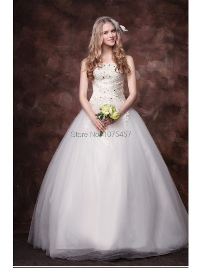 Latest design princess wedding gowns 2015 strapless top for Beaded wedding dress designers