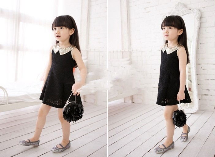 Free shipping!Girls' fashion knee-length with Sequins o-neck dressing,a bow on the back,black or white(China (Mainland))