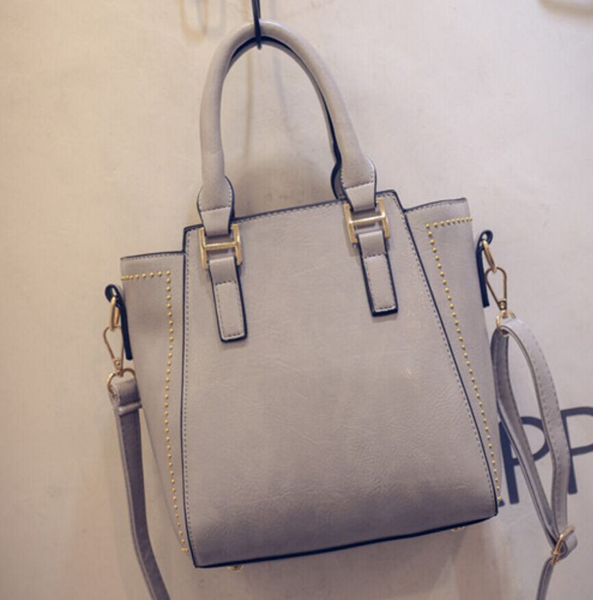 2016 Hot new tide women bag fashion small rivet trapeze bag high quality PU leather handbag shoulder bag wholesale free shipping<br><br>Aliexpress