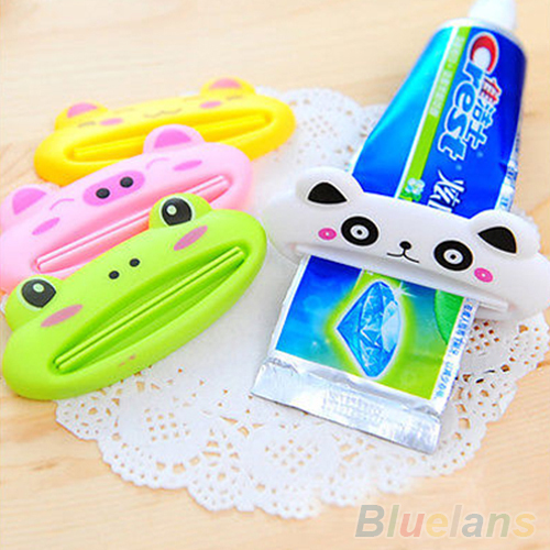 Bathroom Home Tube Rolling Holder Squeezer Easy Cartoon Toothpaste Dispenser 2MVY(China (Mainland))