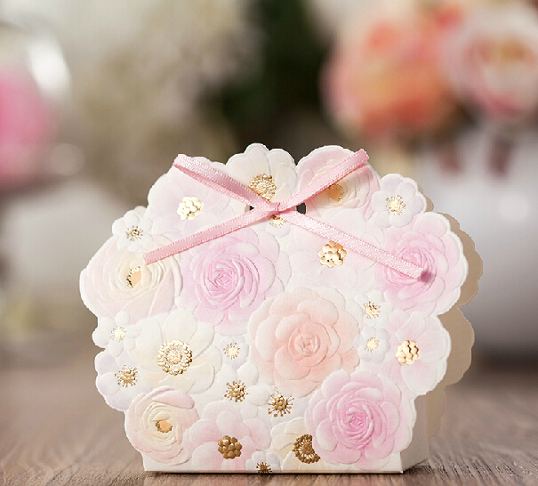 50pcs Romantic Wedding Favors And Gifts Bag Elegant White Luxury Decoration Flower Laser Cut Party Sweet Paper Candy Box(China (Mainland))