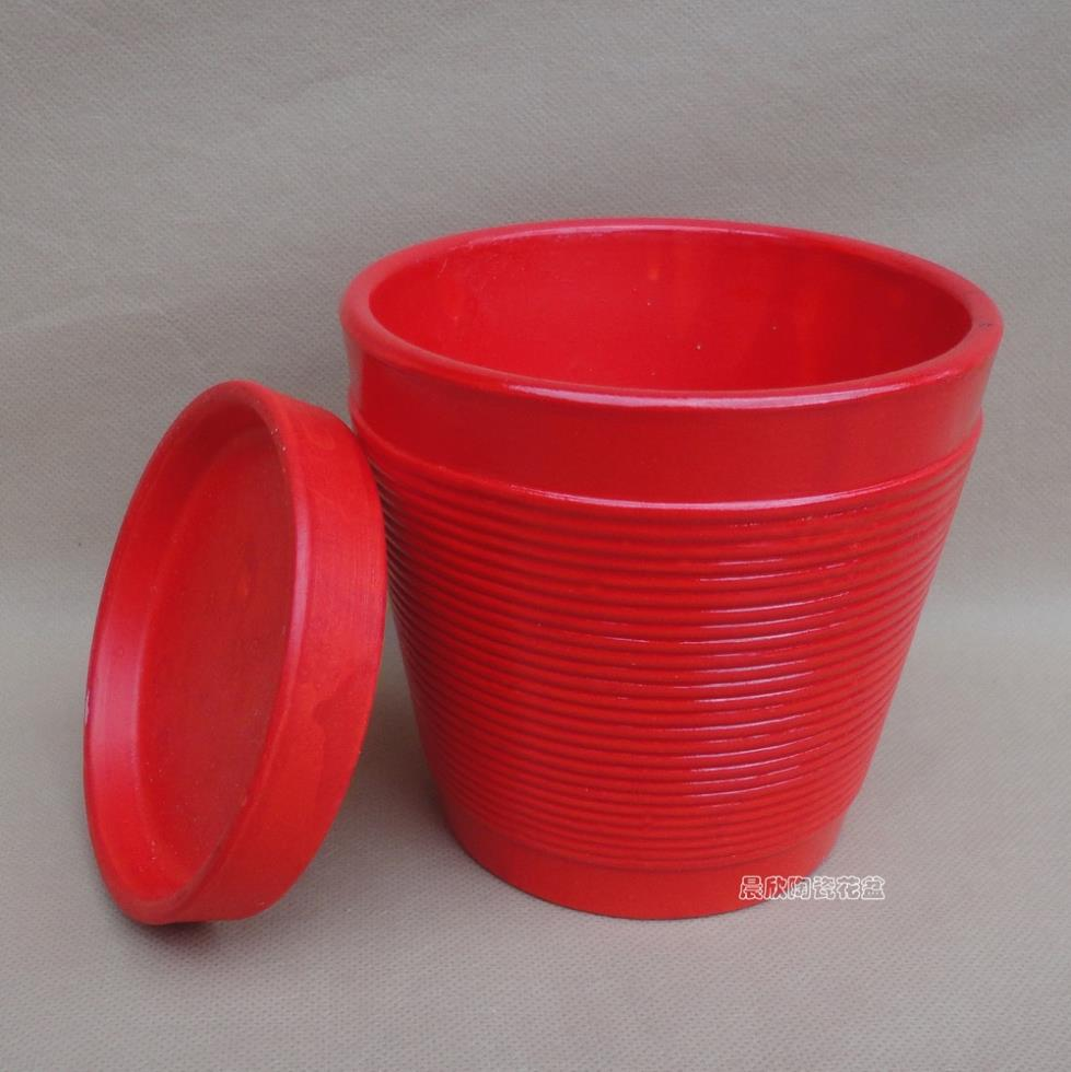 Ceramic POTS of contemporary and contracted 9 cups of stripe Effect of pure red Add the chassis(China (Mainland))